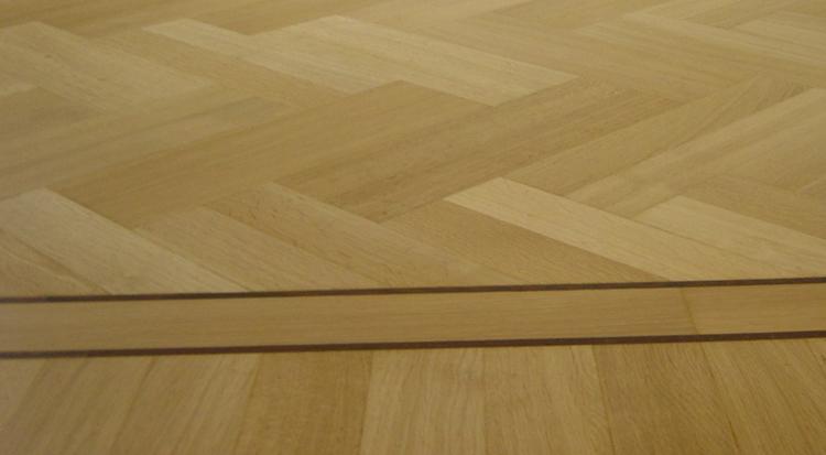 Foto renovatie visgraat vloer | Bouten Parket