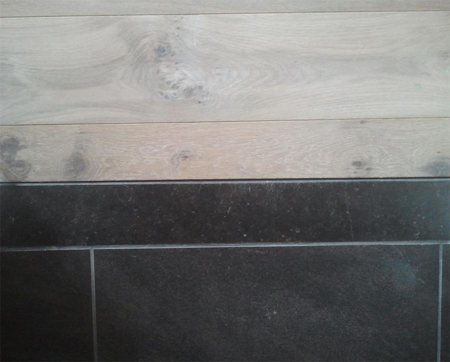 Detailfoto afwerking overgang tegelvloer naar hout | Bouten Parket
